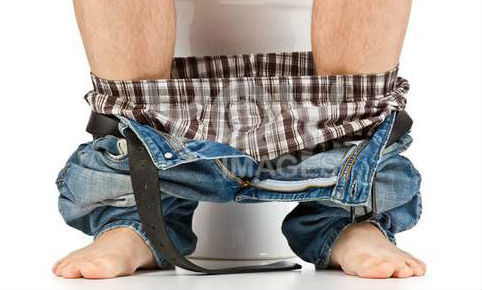 man-is-sitting-on-toilet-247b398